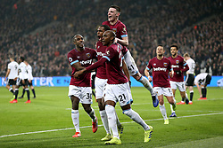 West Ham United's Issa Diop (bottom centre) celebrates scoring his side's second goal of the game with his team mates during the Premier League match at London Stadium.