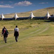 Tourists walk toward Erdene Zuu Khiid monastery in Kharkhorin (Kharkhorin (Karakorum), Mongolia - Sep. 2008) (Image ID: 080910-1650151a)