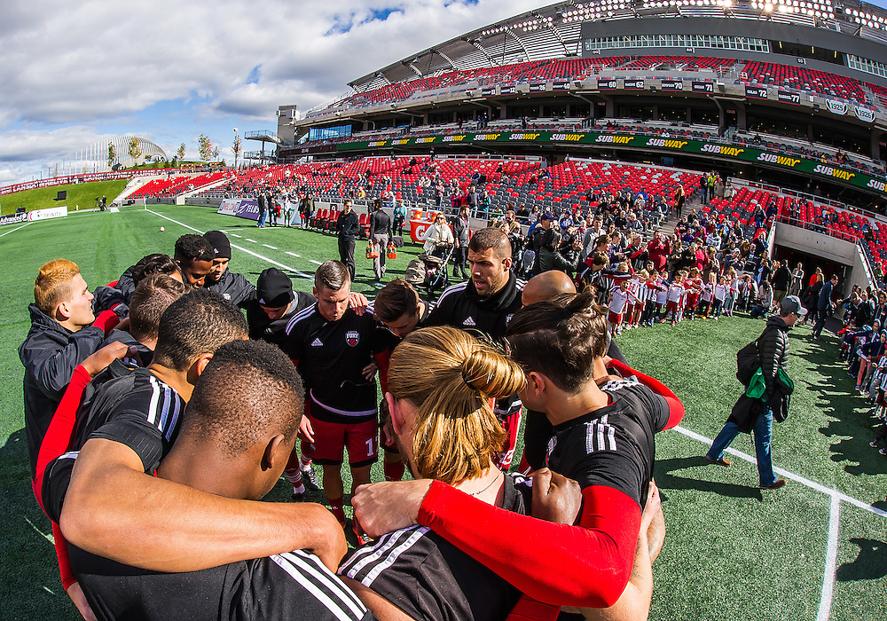 Team huddle before the NASL match between the Ottawa Fury FC and New York Cosmos FC at TD Place Stadium in Ottawa, ON. Canada on Oct. 9, 2016.<br /> <br /> PHOTO: Steve Kingsman/Freestyle Photography