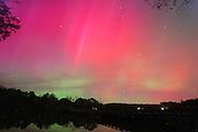 The northern lights or aurora borealis radiates in the sky over the rivanna river 2003 in Charlottesville, Va.