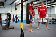 NASCAR driver Kevin Harvick (left) gets some advice during his training session with MMA fighter Johny Hendricks at Velociti Fitness League in Pantego on Wednesday, April 10, 2013. (Cooper Neill/The Dallas Morning News)