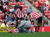 Photo: Andrew Unwin.<br />Sunderland v Barnsley. Coca Cola Championship. 21/10/2006.<br />Sunderland's Kenny Cunningham receives treatment.