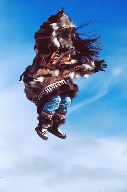 Blanket toss in Barrow, Alaska Native in traditional fur parka