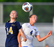 Althoff defender Bree Birdsong (left) and Columbia midfielder Alexa Hildebrand leap for a header. Althoff played Columbia in the sectional championship game at Althoff High School in Belleville, IL on Friday June 11, 2021. <br /> Tim Vizer/Special to STLhighschoolsports.com.