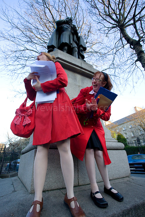 Laughing tour guides at Henry Moore Statue, beside the Meeting of the Waters public toilet, on the Walking Tour of Places of No Historical Interest , Festival of Fools, April 1st 2009, marking April Fool's Day, and the 43rd anniversary of the death of Irish author Flann O'Brien