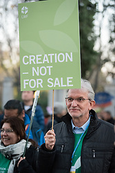 6 December 2019, Madrid, Spain: Lutheran World Federation vice president for Latin America Nestor Friedrich holds a sign reading 'Creation - Not for Sale', as faith-based participants from the Lutheran World Federation, the World Council of Churches and the ACT Alliance join in as thousands upon thousands of people march through the streets of central Madrid as part of a public contribution to the United Nations climate meeting COP25, urging decision-makers to take action for climate justice.