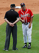 ATLANTA - AUGUST 29:  Manager Bobby Cox #6 of the Atlanta Braves argues a call with third base umpire Mike Everitt #57 after Cox was ejected during the game against the Florida Marlins at Turner Field on August 29, 2010 in Atlanta, Georgia.  The Braves beat the Marlins 7-6.  (Photo by Mike Zarrilli/Getty Images)