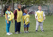 Middletown, New York - Children line up to play play soccer during a program at the Middletown YMCA on April 14, 2012.