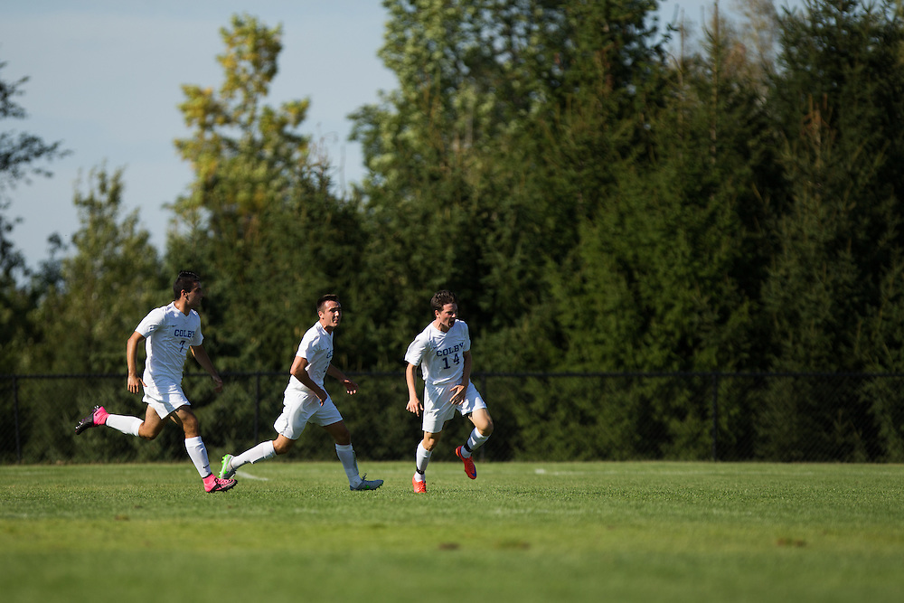 David Howarth, Jeffrey Rosenberg, and Evan Dwyer of Colby College celebrates Rosenberg's goal during a NCAA Division III soccer game against Williams College on September 19, 2015 in Waterville, ME. (Dustin Satloff/Colby College Athletics)