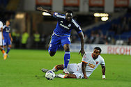 Kenwyne Jones of Cardiff city breaks away from the tackle from Hull city's Tom Huddlestone. Skybet football league championship match, Cardiff city v Hull city at the Cardiff city stadium in Cardiff, South Wales on Tuesday 15th Sept 2015.<br /> pic by Andrew Orchard, Andrew Orchard sports photography.