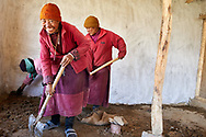 During summer nuns are working to build a primary school for future newcoming nuns - Dorje Dzong nunnery, Zanskar, Jammu-Kashmir, India 2012