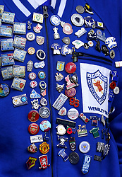 Close up of a Leicester City fans jacket with pins before the Premier League match at Selhurst Park, London. Picture date: Sunday October 3, 2021.