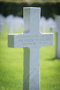 Close-up of white cross at unnamed soldier grave at World War One cemetery, Romagne-sous-Montfaucon, France