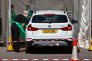 NHS staff see a patient who remains in their car at a drive-through Primary Care Clinical Assessment Centre where potentially infectious and symptomatic Coronavirus patients can be assessed and treated by a doctor or a nurse, in a safe site, on the 16th of April 2020 in Dover, United Kingdom. This is not a COVID-19 testing facility, all patients will only be clinically assessed on site as there is no community testing currently available. All patients have been referred to this centre by NHS 111 or their GP.