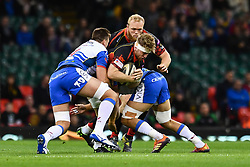 27th April 2019 , Principality Stadium , Cardiff, Wales ; Guinness pro 14's, Round 21, Dragons vs Scarlets ; Aaron Wainwright of Dragons is tackled by Josh Macleod of Scarlets<br /> <br /> Credit :  Craig Thomas/Replay Images