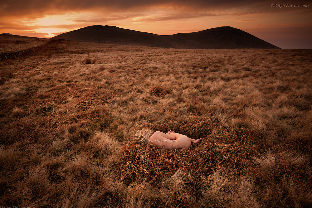 """""""It was too early in the year for the Skylarks, that take off in haste from #moorland grasses, singing for their lives after being disturbed. On this cold Spring evening, within a natural bed of lush grass, lay resting a delicate, #naked woman. I asked her if she was OK and she said """"Yes, it's surprisingly warm here in my nest, but thank you for asking"""". The sun disappeared behind the distant hills, the air cooled dramatically and the woman closed her eyes, and slept"""""""