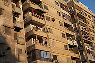 Residents watch an anti-Morsi demonstration pass by below as it heads through central Cairo en route to Tahrir Square.