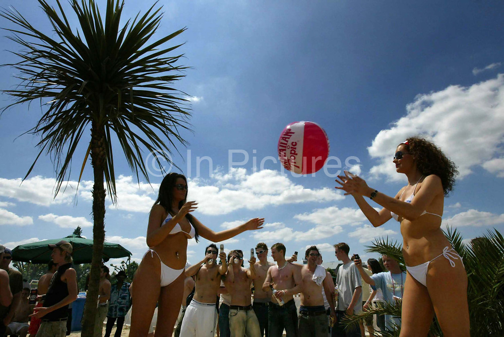 Christiana Dobbie 22 (L) and sister Faith Dobbie (21) play beachball in St Georges Park Wandsworth, South West London, as part of the Sanex Urban Beach Party.