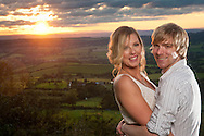 Engaged couple with sun setting over Ottery St Mary, Devon