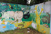 A mural depicting God's garden of Eden on wasteland alongside the river Avon in central Bristol.
