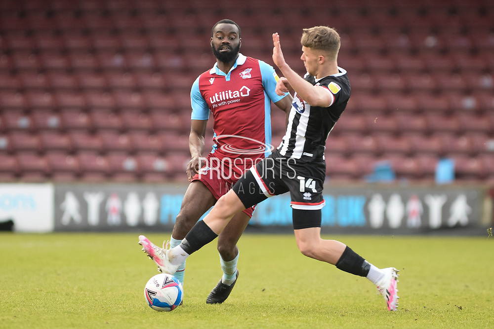 Scunthorpe United Emannuel Onariase (6) plays a pass during the EFL Sky Bet League 2 match between Scunthorpe United and Grimsby Town FC at the Sands Venue Stadium, Scunthorpe, England on 23 January 2021.