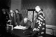 23/04/1964<br /> 04/23/1964<br /> 23 April 1964<br /> Honorary Degrees conferred at the National University of Ireland, Iveagh House, Dublin. <br /> Picture shows Michael W. O'Reilly who received degree of LL.D., Managing Director New Ireland Assurance Co., signing the register after the ceremony watched by President Eamon de Valera (right), Chancellor of N.U.I. and Dr. Seamus Wilmot, Registar of the University.