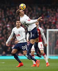 Tottenham Hotspur's Christian Eriksen wins a header during the Premier League match at the Emirates Stadium, London.