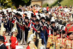 The two newest members, Lady Companion Dame Mary Fagan (front right) and Knight Companion The Viscount Brookeborough (front left) walk at the front of the procession during the annual Order of the Garter Service at St George's Chapel, Windsor Castle.