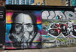 © Licensed to London News Pictures. 23/04/2020. London, UK. A mural of a woman wearing a gas mask is seen in Brick Lane, east London. The public have been told they can only leave their homes when absolutely essential, in an attempt to fight the spread of coronavirus COVID-19. Photo credit: Marcin Nowak/LNP