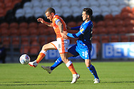 Zac Clough challenges Jay Spearing during the EFL Sky Bet League 1 match between Blackpool and Rochdale at Bloomfield Road, Blackpool, England on 6 October 2018.