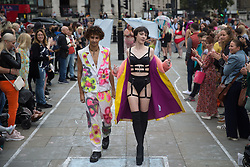 © Licensed to London News Pictures.  25/09/2021. London, UK. Models take part in the Real Catwalk in Trafalgar Square, central London.The day is a celebration of every type of person and a testament to power in numbers - walking a runway, with 90+ women who all had a different story. Photo credit: Marcin Nowak/LNP