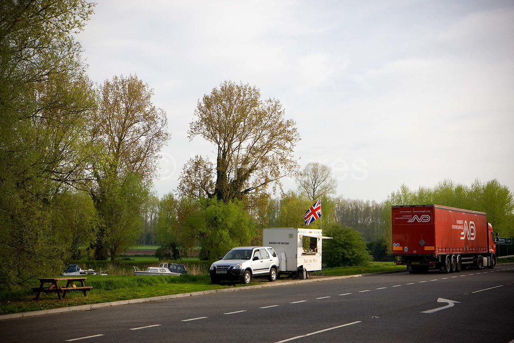 A burger van and picnic area positioned at a rural roadside layby along the A10 trunk road on the 28th April 2010 in Hilgay in the United Kingdom. The burger van called Snax on Trax is opposite the River Wissey.