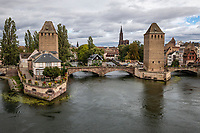ThePonts Couverts - The Covered Bridges of Strasbourg is a set of three bridges and four towers that were set up to defend Strasbourg.Each of the bridges were once covered by a wooden roof although the roofs were removed in 1784 but the namePonts Couvertscovered bridges has stuck nevertheless.  After the annexation of Strasbourg to France in 1681 another set of fortifications was built by Vauban to acccompany the Vauban Dam.