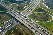 Nederland, Zuid-Holland, Gemeente Gorinchem, 01-04-2016; knooppunt Gorinchem, kruising A27 (linksboven-rechtsonder) en A15 met langzaam rijdend en stilstaand verkeer.<br /> Gorinchem junction.<br /> luchtfoto (toeslag op standard tarieven);<br /> aerial photo (additional fee required);<br /> copyright foto/photo Siebe Swart