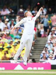 © Licensed to London News Pictures. 03/01/2014. Ben Stokes jumps up to stop the ball during the 5th Ashes Test Match between Australia Vs England at the SCG on 03 January, 2013 in Melbourne, Australia. Photo credit : Asanka Brendon Ratnayake/LNP