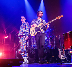 Frontman Olly Alexander and bass guitarist Mikey Goldsworthy. Years & Years on stage at the O2 Academy Glasgow, Glasgow, Scotland.