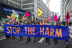 Environmental activists from Extinction Rebellion arrive at the Department for Business, Energy and Industrial Strategy (BEIS) at the end of a Stop The Harm march during the fourth day of Impossible Rebellion protests on 26th August 2021 in London, United Kingdom. Extinction Rebellion are calling on the UK government to cease all new fossil fuel investment with immediate effect.