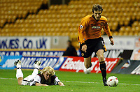 Photograph: Scott Heavey.<br />Wolverhampton Wanderers v Darlington.  Carling Cup 2nd  Round. 23/09/2003.<br />Lee Naylor leaves Chris Hughes laying in his path.