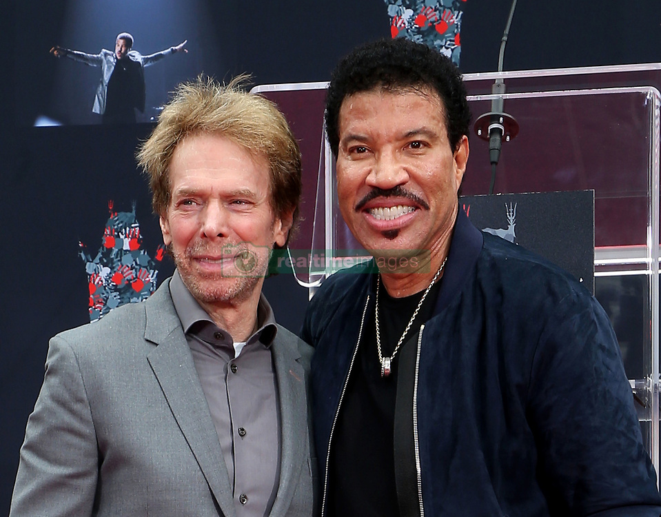 07 March 2018 - Hollywood, California - Jerry Bruckheimer and Lionel Richie. Lionel Richie Hand and Footprint Ceremony held at TCL Chinese Theatre. Photo Credit: F. Sadou/AdMedia