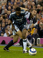 Photo: Glyn Thomas.<br />West Bromwich Albion. Newcastle Utd. The Barclays Premiership. 30/10/2005.<br /> Newcastle's Charles N'Zogbia (L) battles with West Brom's Riccardo Scimeca.