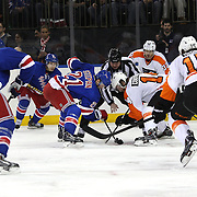 A face off  during the New York Rangers Vs Philadelphia Flyers, NHL regular season game at Madison Square Garden, New York, USA. 26th March 2014. Photo Tim Clayton
