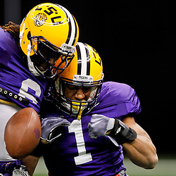 January 5, 2012; New Orleans, LA, USA; LSU Tigers safety Eric Reid (1) has the ball ripped away by safety Craig Loston (6) on a drill during practice for the 2012 BCS National Championship game to be played on January 9, 2012 against the Alabama Crimson Tide at the Mercedes-Benz Superdome.  Mandatory Credit: Derick E. Hingle-US PRESSWIRE