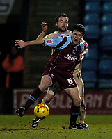 Photo: Jed Wee.<br /> Scunthorpe United v Bristol City. Coca Cola League 1. 14/02/2006.<br /> <br /> Scunthorpe's Cliff Byrne (R) holds off Bristol's Marcus Stewart.