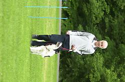 Eddie Sander with his Dogs Jackson and Inka<br /><br />18 June 2004<br /><br />Copyright Paul David Drabble<br /> [#Beginning of Shooting Data Section]<br />Nikon D1 <br /> Focal Length: 200mm<br /> Optimize Image: <br /> Color Mode: <br /> Noise Reduction: <br /> 2004/06/18 09:13:45.0<br /> Exposure Mode: Programmed Auto<br /> White Balance: Auto<br /> Tone Comp: Normal<br /> JPEG (8-bit) Fine<br /> Metering Mode: Multi-Pattern<br /> AF Mode: AF-S<br /> Hue Adjustment: <br /> Image Size:  2000 x 1312<br /> 1/125 sec - F/6<br /> Flash Sync Mode: Not Attached<br /> Saturation: <br /> Color<br /> Exposure Comp.: 0 EV<br /> Sharpening: Normal<br /> Lens: 80-200mm F/2.8<br /> Sensitivity: ISO 200<br /> Image Comment: <br /> [#End of Shooting Data Section]