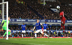 Liverpool's Sadio Mane (right) heads toward goal during the Premier League match at Goodison Park, Liverpool.