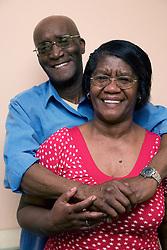 Older couple embracing,