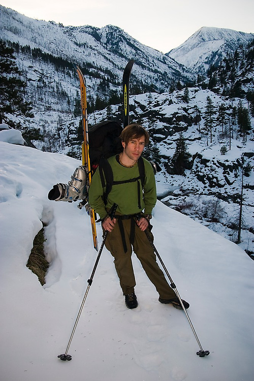Jon Jantz poses with his skis strapped to his backpack near the Snow Creek trailhead - access to the Enchantments - in the Alpine Lakes Wilderness, Washington.