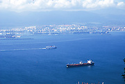 The view of the strait and port of Gibraltar, the British overseas territory. Morocco in the background