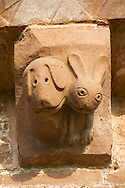 Norman Romanesque exterior corbel no 33  -  sculpture of.very modern cartoon like hound and a hare. In the Bestiary dogs are like preachers who put men back on the right course of righteousness and the hare represents men who fear God and put their trust in the creator . The Norman Romanesque Church of St Mary and St David, Kilpeck Herefordshire, England. Built around 1140 .<br /> <br /> Visit our MEDIEVAL PHOTO COLLECTIONS for more   photos  to download or buy as prints https://funkystock.photoshelter.com/gallery-collection/Medieval-Middle-Ages-Historic-Places-Arcaeological-Sites-Pictures-Images-of/C0000B5ZA54_WD0s