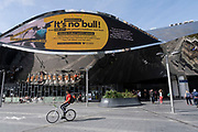 As numbers of Covid-19 cases in Birmingham have dramatically risen in the past week, increased lockdown measures have been announced for Birmingham and other areas of the West Midlands, people interact beneath a public health advice advertising campaign featuring Bully the Bull Ring bull wearing a face mask with the slogan 'It's NO bull. Keep Brum safe' outside Grand Central station in the city centre on 12th September 2020 in Birmingham, United Kingdom. With the rule of six also being implemented the Birmingham area has now be escalated to an area of national intervention, with a ban on people socialising with people outside their own household, unless they are from the same support bubble.